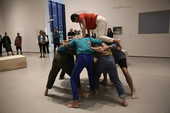 Simone Forti. <em>Huddle</em>. 1961. Performance. Committee on Media and Performance Art Funds. Performed in <em>Judson Dance Theater: The Work Is Never Done</em>, The Museum of Modern Art, New York, September 16, 2018&ndash;February 3, 2019. Performers: Martita Abril (top), Vanessa Vargas, Alexis Ruiseco-Lombera, Lindsay Londs Reuter, Samuel Hanson, Christiana Cefalu, Elizabeth Hart, Laura Pfeffer, Miguel &Aacute;ngel Guzm&aacute;n. Digital image &copy; 2018 The Museum of Modern Art, New York. Photo: Paula Court.