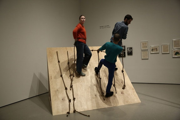 Simone Forti. <em>Slant Board</em>. 1961. Performance with plywood and rope. Committee on Media and Performance Art Funds. Performed in J<em>udson Dance Theater: The Work Is Never Done</em>, The Museum of Modern Art, New York, September 16, 2018&ndash;February 3, 2019. Performers, from left: Laura Pfeffer, Alexis Ruiseco-Lombera, Samuel Hanson. Digital image &copy; 2018 The Museum of Modern Art, New York. Photo: Paula Court.
