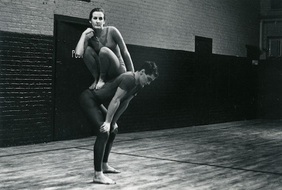 Peter Moore's photograph of Trisha Brown and Steve Paxton in Trisha Brown's Lightfall, 1963. Performed at Concert of Dance #4, Judson Memorial Church, New York, January 30, 1963 © Barbara Moore\ Licensed by VAGA, New York, NY. Courtesy Paula Cooper Gallery,New York