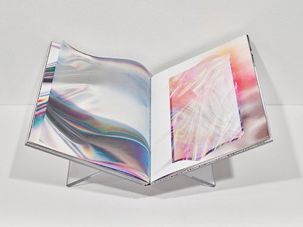 Anne Vieux, <em>Transitory Flatspace</em>, German case bound in lenticular fabric, full color archival pigment prints with holographic foil blocking and 8 translucent leaves, Edition of 15 + 2APs, 9 x 12 inches, 60 pages, + facsimile of original that can be handled without gloves. Published by Small Editions Press. Photo: Frank Oudeman.