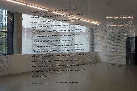 Martha Rosler, <em>Reading Hannah Arendt (Politically, for an Artist in the 21st Century) </em>(detail), 2006. Installation with excerpts from Hannah Arendt's writings, in English and German, on transparent vinyl panels. © Martha Rosler.