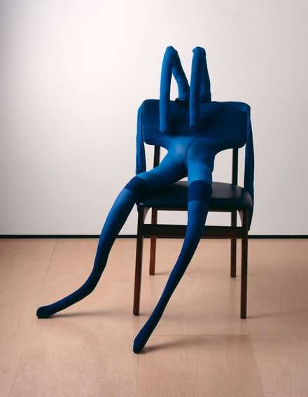 Sarah Lucas, <em>Bunny Gets Snookered #8</em>, 1997. Blue tights, navy stockings, vinyl and wood chair, clamp, kapok, and wire, 39 x 34 x 31 1/8 inches. © Sarah Lucas. Courtesy Sadie Coles HQ, London.