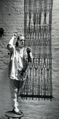 <p>Lenore Tawney with<em> Vespers</em>, South Street studio, 1961.  Photo: Ferdinand Boesch, courtesy Lenore G. Tawney Foundation.</p>