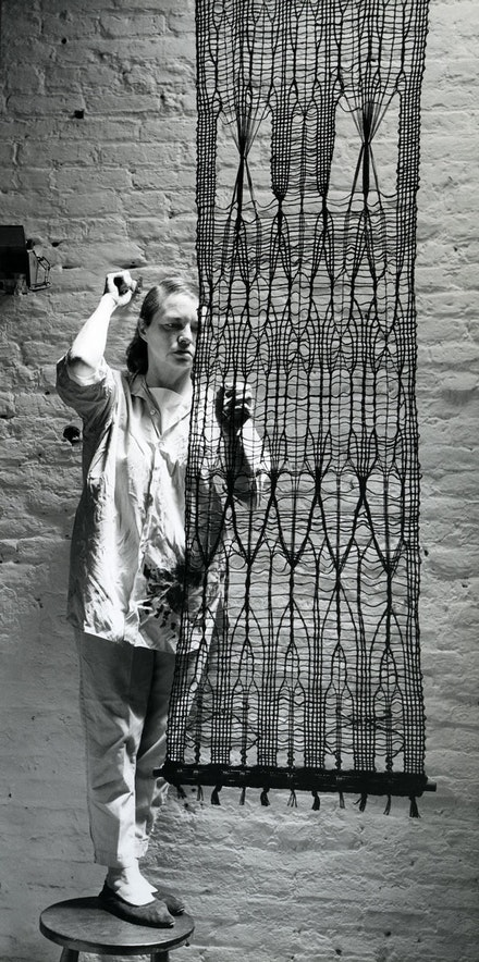 <p>Lenore Tawney with<em>&nbsp;Vespers</em>, South Street studio, 1961.&nbsp; Photo: Ferdinand Boesch, courtesy Lenore G. Tawney Foundation.</p>