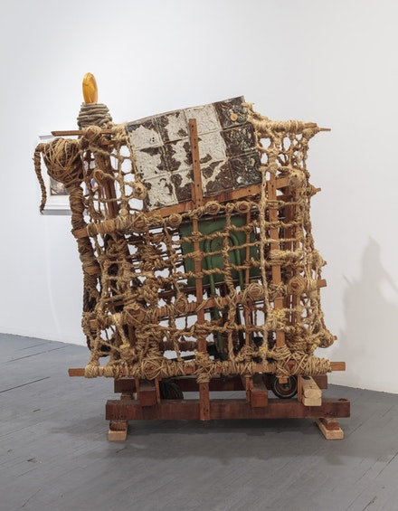 Arthur Simms, A Ride for the Massive, 1993. Rope, Wood, Glue, Metal, Screws, Wheel Cart, Plastic, 77 1/2 x 65 x 39 inches. Photo: JSP Art Photography
