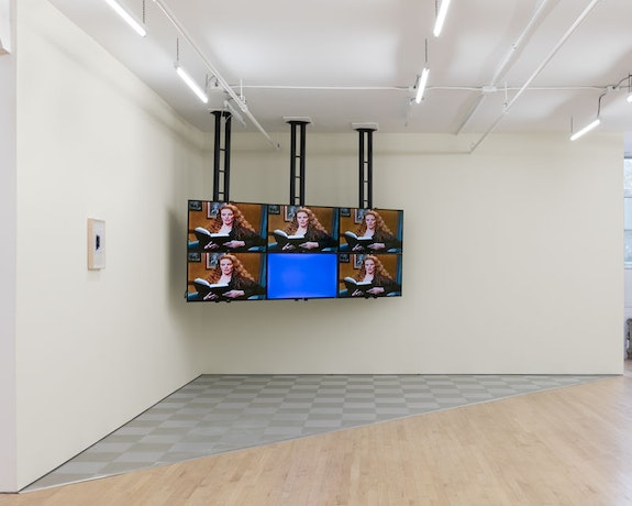Sable Elyse Smith, <em>Room One: The Watcher</em>, 2018. 6-channel synchronized video, monitors, sound, custom floor, paint in timid white, dimensions variable. Courtesy JTT New York.