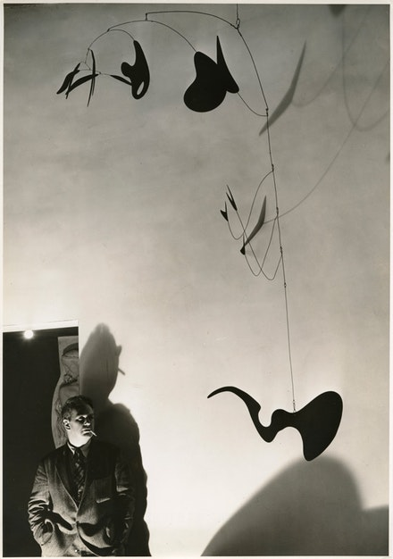André Kertesz, <em>Alexander Calder with Eucalyptus (1940)</em>, 1940. © Copyright ARS, NY. © André Kertesz - RMN. Courtesy the Calder Foundation, New York / Art Resource, NY.