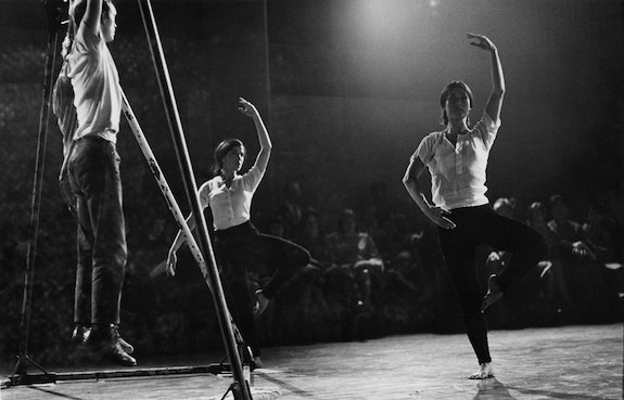 Peter Moore's photograph of Alex Hay, Deborah Hay, and Yvonne Rainer performing Hay's <em>Would They or Wouldn't They?</em>, 1963. Performed at Concert of Dance #13, Judson Memorial Church, New York, November 20, 1963. © Barbara Moore/Licensed by VAGA, New York, NY. Courtesy Paula Cooper Gallery, New York.