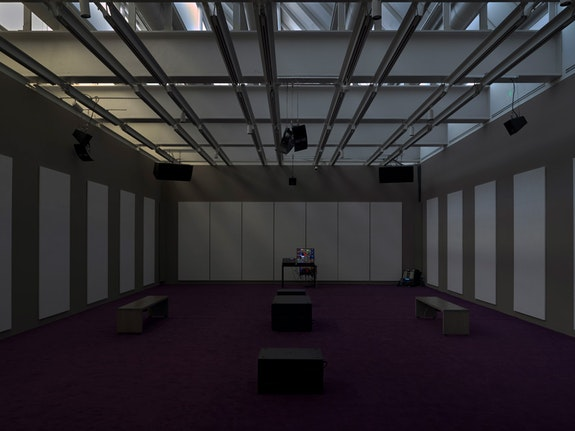 <p>Kevin Beasley, <em>A view of a landscape: A cotton gin motor</em>, 2012-18. Installation view, Whitney Museum of American Art, New York, 2018&ndash;2019. Custom Speaker system, subwoofers, amplifiers, AD/DA interface, Ethernet switch, mixer, modular synthesizer, equipment racks, and wood table. Courtesy Casey Kaplan, New York. Photo: Ron Amstutz.</p>