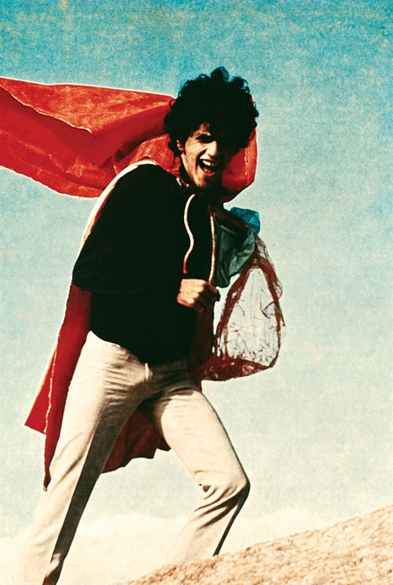Singer and composer Caetano Veloso wearing Hélio Oiticica's <em>Parangolé P4 Cape1</em> (1964), 1968. Photo: Geraldo Viola. © César and Claudio Oiticica. Courtesy Projeto Hélio Oiticica, Rio de Janeiro and Galerie Lelong & Co., New York.