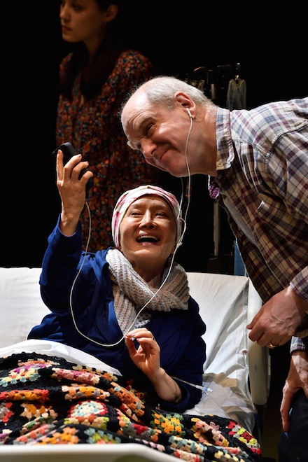 <p>The Rose family's matriarch Masako (Ako) and her husband James (Jay Patterson) in <em>God Said This</em>; background: Emma Kikue as daughter Sophie. Photo: Jonathan Roberts.</p>