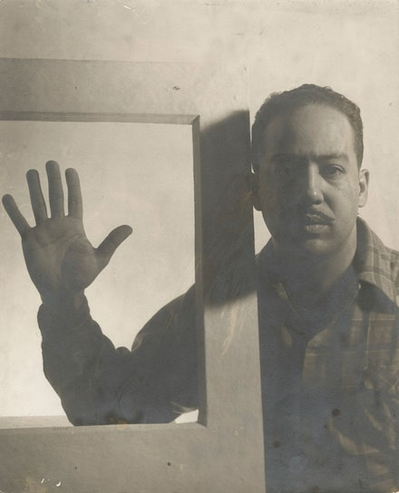 Gordon Parks, <em>Langston Hughes, Chicago, December 1941. </em>Gelatin silver print, 13 1/8 x 10 5/8 inches. © and courtesy The Gordon Parks Foundation.