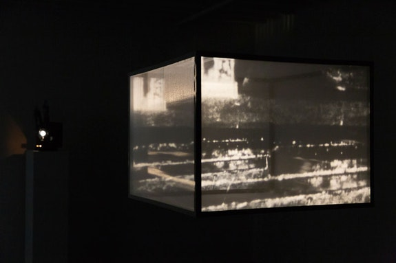 Raha Raissnia, <em>Galvanoscope 1</em>, 2018. Projector, 16 mm film, 3 min. loop, wood, scrim, installation dimensions variable. Courtesy the artist and Miguel Abreu Gallery, New York. Photo: Stephen Faught.