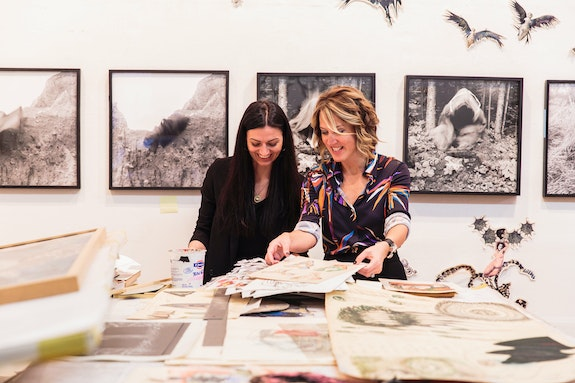 Kathleen Landy and Katie McCarty at Mary Beth Edelson's studio. Photo credit: Kolin Mendez Photography