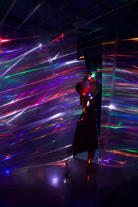 Belinda Becker performing inside Barbara Campisi's installation, <em>A Sound Of Light appearing around the bend</em>, at FiveMyles, 2019. Courtesy FiveMyles.