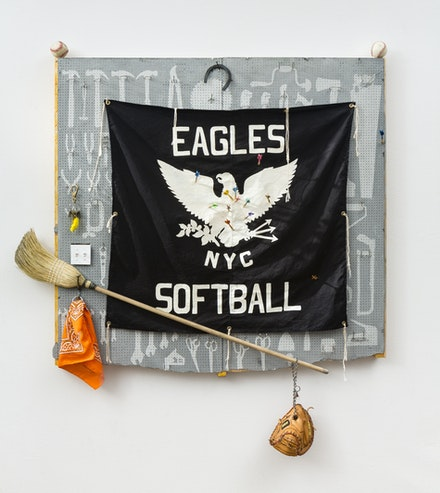 Charles LeDray, <em>Eagles Softball</em>, 2016–2018. Eucaboard, wood, metal, leather, fabric, rabbit fur, cotton fiber, embroidery floss, rhodium and gold plate, wax, lacquer, paint, glow in the dark paint, straw paint, straw, 39 1/4 x 32 1/4 x 4 5/8 inches. Courtesy the artist and Peter Freeman, Inc. Photo: Nicholas Knight Studio.