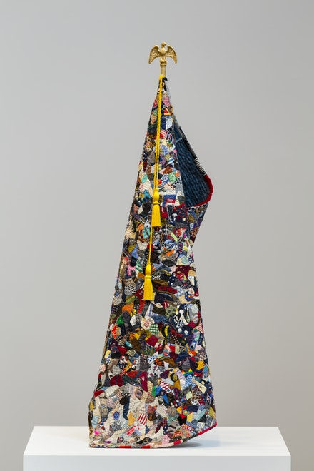 Charles LeDray, <em>American Standard / Crazy Quilt</em>, 2017–2018. Fabric, thread, fiber fill, brass, bronze, patina, gold plate, stainless steel, embroidery floss, viscose thread, wax, 34 1/4 x 5 inches diameter. Courtesy the artist and Peter Freeman, Inc. Photo: Nicholas Knight Studio.