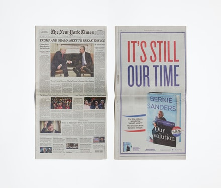 <p>Taryn Simon, <em>The New York Times, Friday, November 11</em>, 2016 (front and back view). The New York Times newspaper (dated November 11, 2016) in glass display cabinet, 22 x 12 1/4 x 3/8 inches. Photo: Courtesy the artist.</p>
