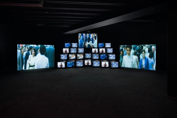 <p>Gretchen Bender, <em>Total Recall</em>, 1987. 11-channel video installation on 24 monitors and 3 projection screens, 18.2 minutes, with soundtrack by Stuart Argabright.Photo: Lance Brewer. © The Gretchen Bender Estate. </p>