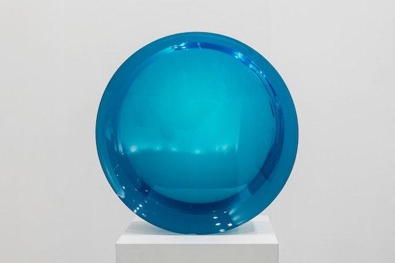 De Wain Valentine, <em>Concave Circle Blue Green</em>, 1968 &ndash; 2017. Cast polyester resin, 23 1/2 x 23 1/2 x 9 7/8 inches. &copy; De Wain Valentine. Courtesy of the artist and Almine Rech. Photo: Melissa Castro Duarte.