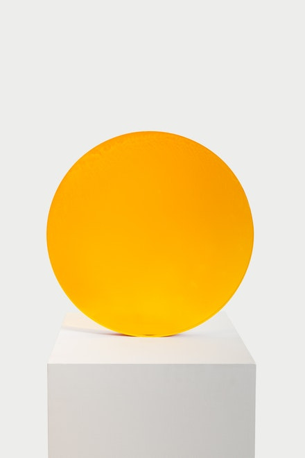 De Wain Valentine, <em>Amber to Gold Circle</em>, 1971. Cast polyester resin, 17 1/2 x 17 1/2 x 1 5/8 inches. © De Wain Valentine. Courtesy the artist and Almine Rech. Photo: Matt Kroening.