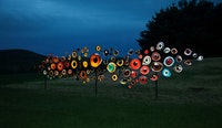 Jenny Kendler, Birds Watching, 2018. Printed reflective film mounted on aluminum with steel frame, 120 x 480 x 10 inches. Part of <em>Indicators: Artists on Climate Change</em>, Storm King Art Center. Depicts 100 eyes of bird species threatened or endangered by climate change. Courtesy of the artist.