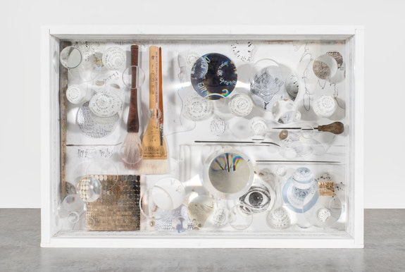 Mary Bauermeister (b.1934),<em> Brian O'Doherty Commentary Box</em>, 2017, ink, stone, offset print, glass, glass lens, paint brush, metal and wood tools and painted wood construction, 17