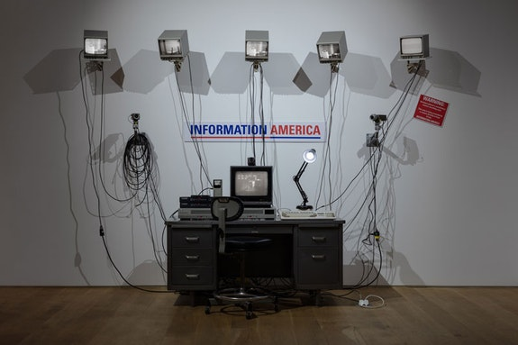 <p>Julia Scher, <em>Information America</em>, 1995, Metal office desk, 5 9