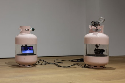 <p>Julia Scher, <em>American Tanks</em>, 2001, 2 modified gas cylinders, OLED TFT color monitor, digital color CCD camera, speakers, amplifier, CD, player, cables. Overall dimensions variable (each cylinder: 25 1/2 x 12 1/2 x 12 1/2 inches). Courtesy Ortuzar Projects.</p>