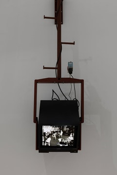 <p>Julia Scher,<em> Mothers Under Surveillance</em>, 1993, Live black-and-white camera with 16mm lens, 25