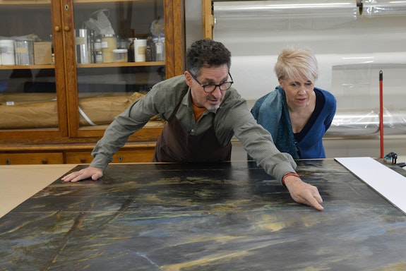 George Bisacca with Gerlinde Gruber of the Kunsthistorisches Museum looking at the Rubens <em>Stormy Landscape</em>, Vienna.