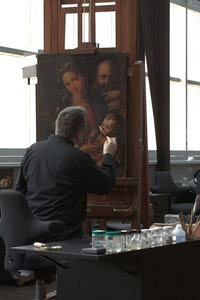 Michael Gallagher in studio with Perino del Vaga,<em> The Holy Family with Infant Saint John the Baptist</em>, ca. 1524 - 26. Oil on wood. Courtesy Michael Gallagher.