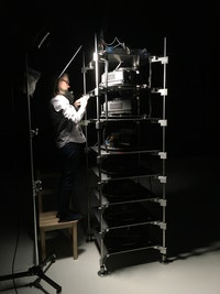 Kate Lewis working on the installation of Teiji Furuhashi, <em>Lovers</em>, 1994, Computer controlled, five-channel laser disc/sound installation with five projectors, two sound systems, two slide projectors, and slides (color, sound). The Museum of Modern Art, New York. Gift of Canon Inc., 1998. © 2019 DUMB TYPE. Photo: Ben Fino-Radin.