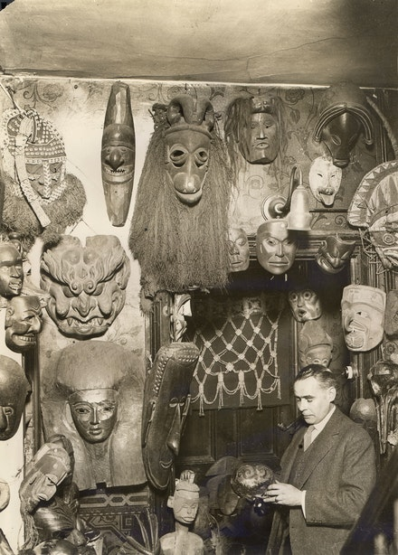 Pacific and Atlantic Photos Ltd., <em>W.O. Oldman with masks and headdresses,</em> c. 1920. Gelatin silver print, 8 x 10 inches, Te Papa. Courtesy ICA Philadelphia.