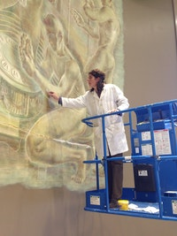 Lisa Rosen at work on entrance mural at Bulova building, Queens, NY, 2011. Courtesy Lisa Rosen.