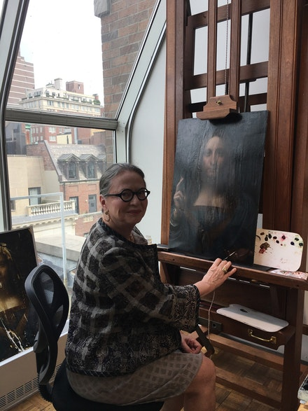 Diane Modestini in studio with Leondaro Da Vinci's <em>Salvator Mundi.</em>