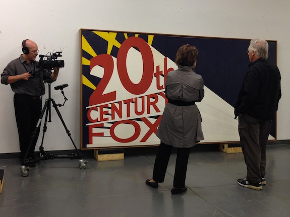 Carol Mancusi-Ungaro interviewing artist Edward Ruscha. Pictured: <em>Large Trademark with Eight Spotlights,</em> 1962, by Edward Ruscha. Oil, house paint, ink, and graphite pencil on canvas, 66 15/16 × 133 1/8 in. (170 × 338.1 cm). Whitney Museum of American Art, New York; purchase with funds from the Mrs. Percy Uris Purchase Fund 85.41. © Ed Ruscha. Photograph by Heather Cox