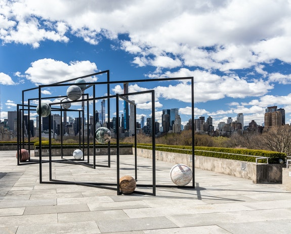 Installation view: The Roof Garden Commission: Alicja Kwade, ParaPivot, The Metropolitan Museum of Art, 2019. Courtesy the artist; 303 Gallery, New York; KO?NIG GALERIE, Berlin/London; and kamel mennour, Paris/London.Courtesy the Metropolitan Museum of Art, Photo: Hyla Skopitz