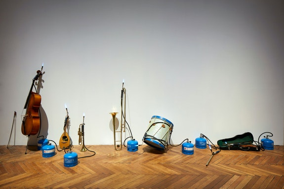 Jannis Kounellis, Untitled, 1980. Flute, violin, drum, trumpet, cornet, cello, mandolin, gas tank, flames. Courtesy Fondazione Prada. Photo: Agostino Osio - Alto Piano.