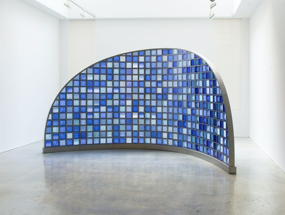 Josiah McElheny, <em>Moon Mirror</em>, 2019. Pressed colored prismatic glass, stainless steel, hardware, 103 x 191 1/2 x 71 inches. © Josiah McElheny 2019. Courtesy the artist and James Cohan, New York.