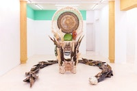 Guadalupe Maravilla, <em>Disease Thrower #5</em>, 2019. Mixed media sculpture, shrine, instrument, headdress, 91 x 55 x 45 inches. Courtesy Jack Barrett Gallery, New York.