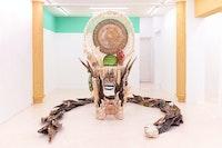 Guadalupe Maravilla, <em>Disease Thrower #5</em>, 2019. Mixed media sculpture, shrine, instrument, headdress, 91 x 55 x 45 inches. Courtesy Jack Barrett Gallery, New York.