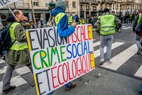 Yellow Vest demonstration in Paris, February 9, 2019. Translation of sign: