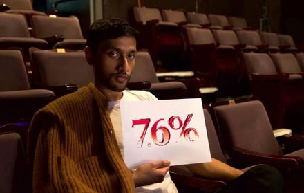 LIT Council member Nikhil Mahapatra with 7.6% sign: 7.6% of all plays produced in the United States are written by men of color. Photo: Beto O'Byrne.
