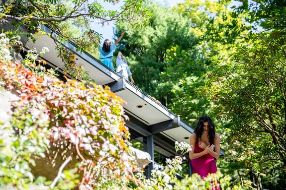 Ivy Baldwin Dance, <em>Quarry</em> at Manitoga. Pictured: Kay Ottinger (foreground), Tara Sheena and Katie Dean (roof). Photo: Maria Baranova.