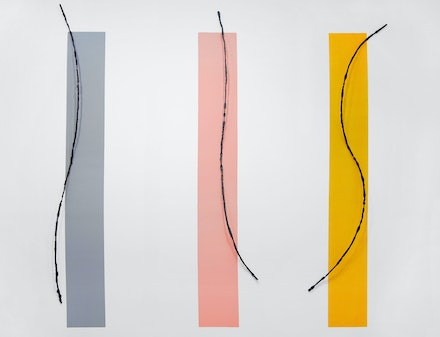 Alain Kirili, <em>Ascension II</em>, 2018. Forged iron on painted yellow, gray, and pink wall 141 3/8 x 143 1/2 x 4 inches. overall. Courtesy Susan Inglett Gallery, NYC.