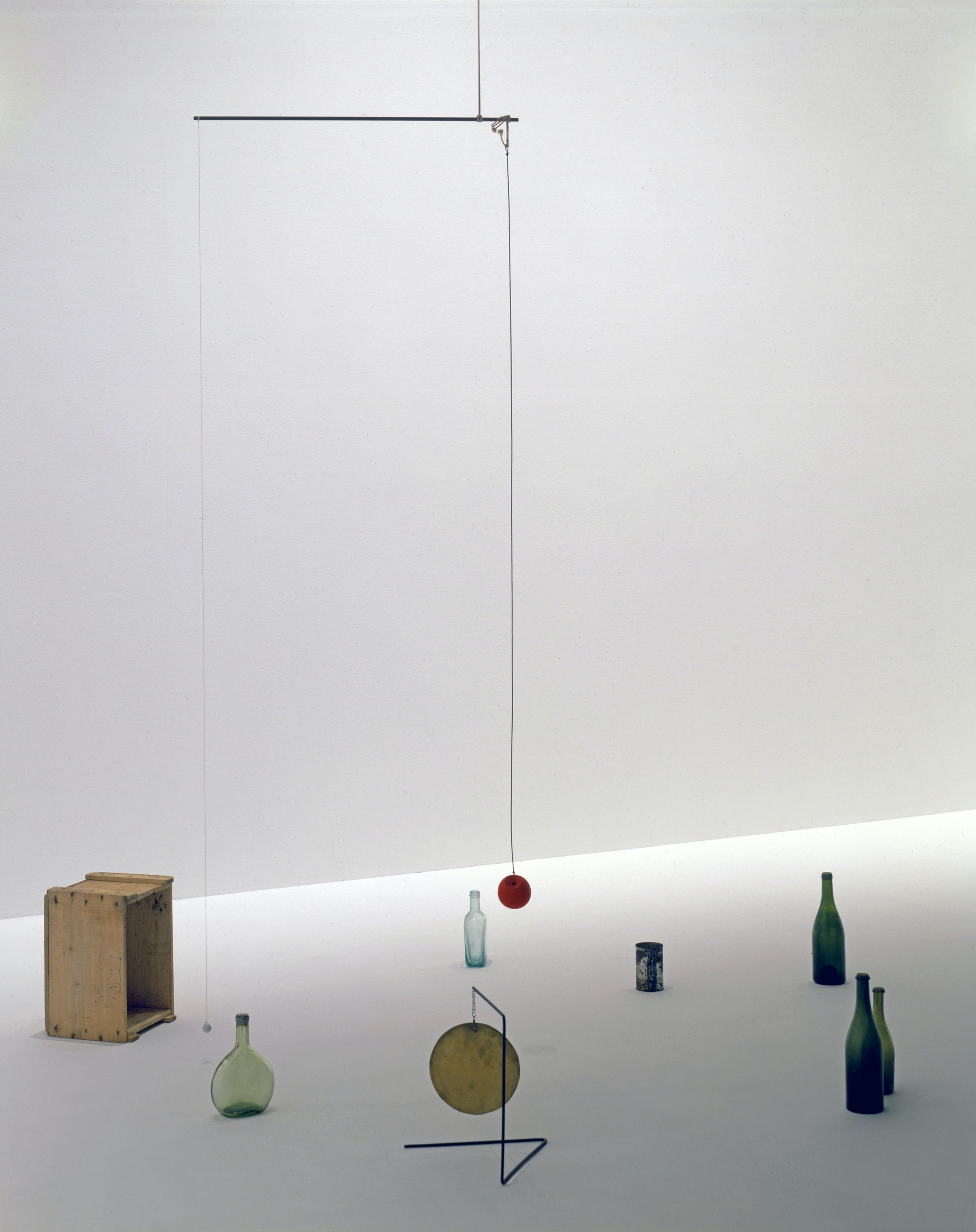 Alexander Calder, <em>Small Sphere and Heavy Sphere</em>, 1932/1933. Cast iron, rod, wire, wood, cord, thread, paint, and impedimenta, dimensions variable. © 2019 Calder Foundation, New York /Artists Rights Society (ARS), New York. Photo: Calder Foundation, New York / Art Resource, New York.