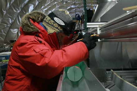 The author measuring the WAIS ice core into one-meter-long sections. Photo: Gifford Wong.