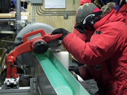 The author cutting the WAIS ice core into one-meter-long sections. Photo: Chad Naughton/NSF.