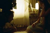Alexa Shae Niziak and Graham Swon on the set of <em>The World is Full of Secrets</em>. Courtesy the filmmaker.